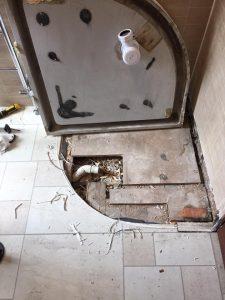 leak below a shower basin